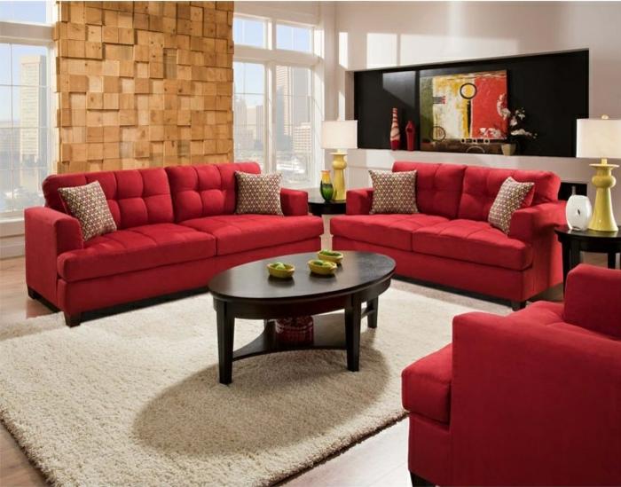 rote sofas wohnzimmer schöne akzentwand ovaler couchtisch