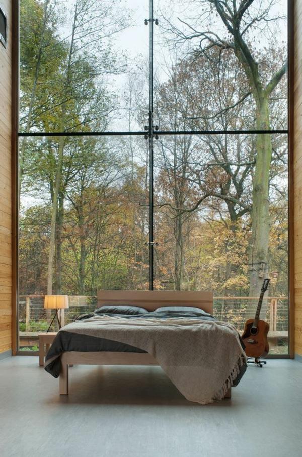 schlafzimmergestaltung schöne aussicht wald panoramafenster