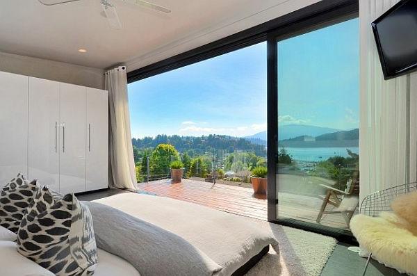 schlafzimmergestaltung weißer kleiderschrank panoramafenster