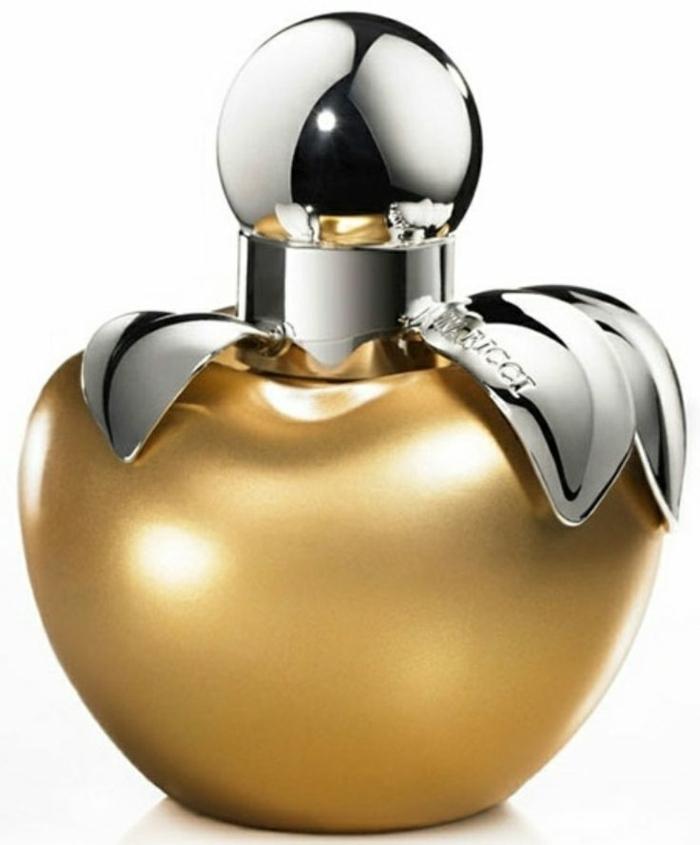 Nina Ricci parfüm luxus accessoires gold