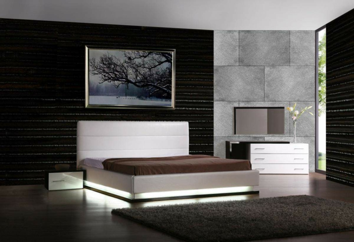 schlafzimmer einrichten dunkles interieur leuchtendes bett teppich