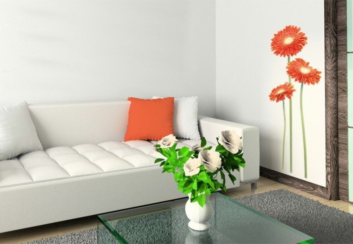 wandtattoos wohnzimmer orange gerbera weißes sofa