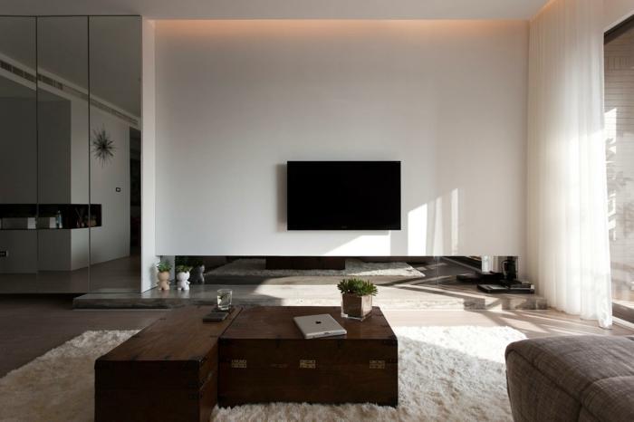 wohnzimmer einrichten minimalistisch weißer teppich rustikaler couchtisch
