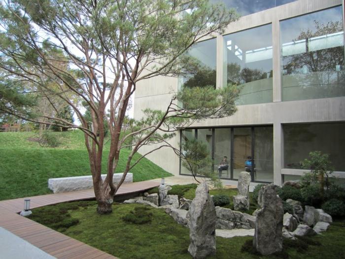 Steinfiguren für den Garten Moos Stein japanischer garten