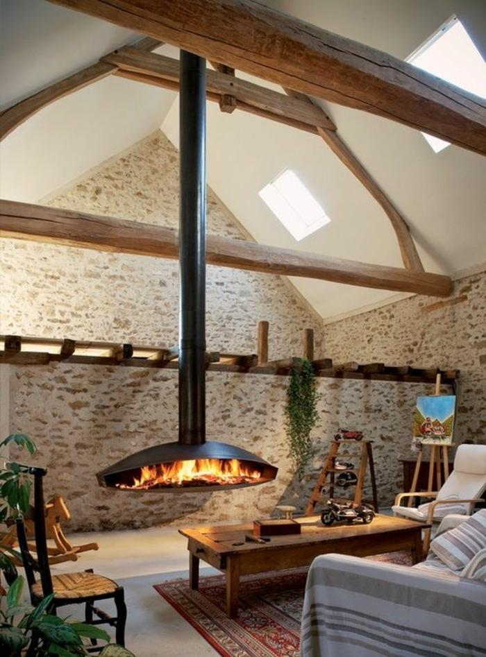 moderne kaminöfen wohnzimmer steinwand teppich pflanzen
