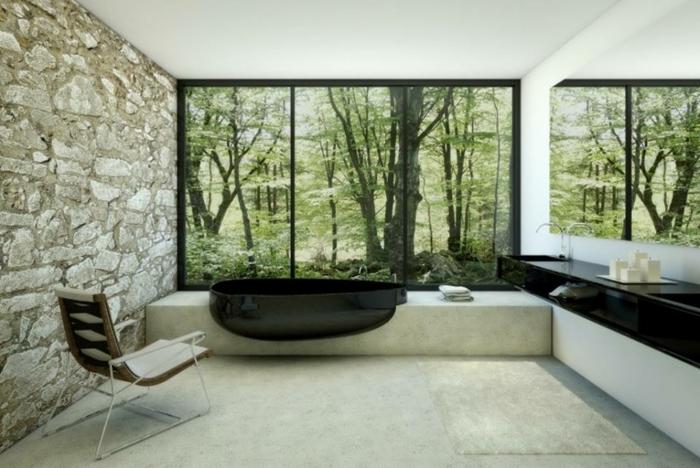 modernes badezimmer badewanne schwarz oval steinwand