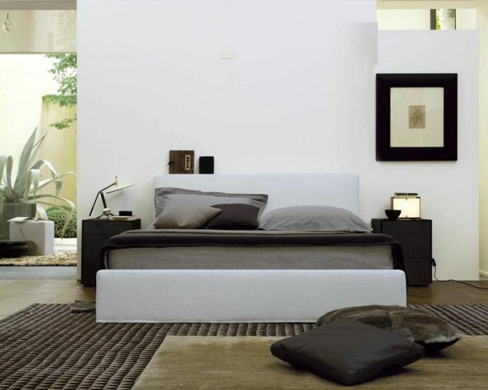 schlafzimmer einrichten schlicht stilvoll teppich bodenkissen
