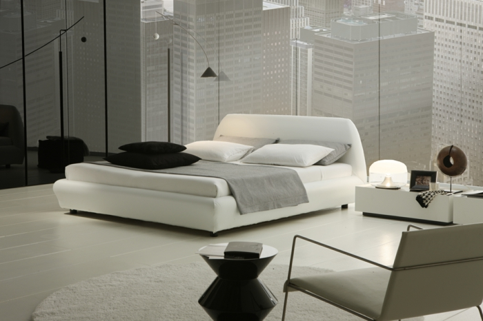 schlafzimmer einrichten weiß schwarz runder teppich