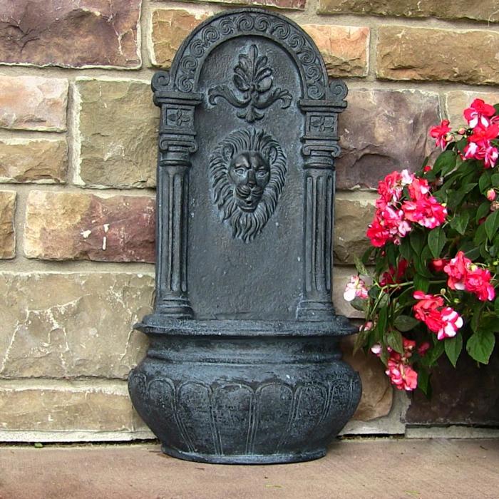 wandbrunnen elegantes design blumen steinwand
