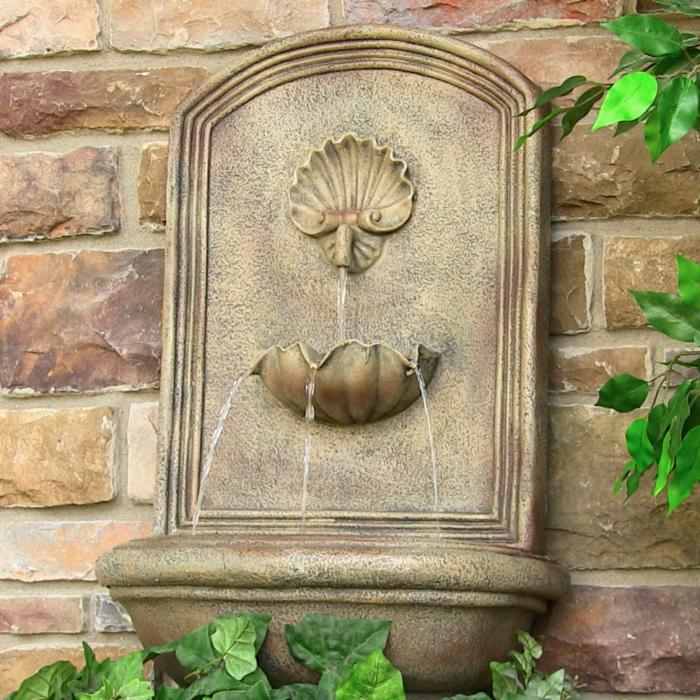wandbrunnen garten gestalten dekoideen steine pflanzen