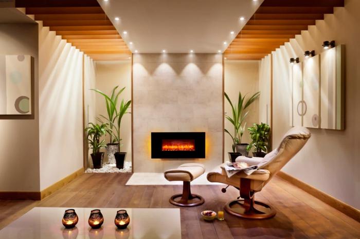 moderne kamine wand design wohnzimmer sessel hocker pflanzen