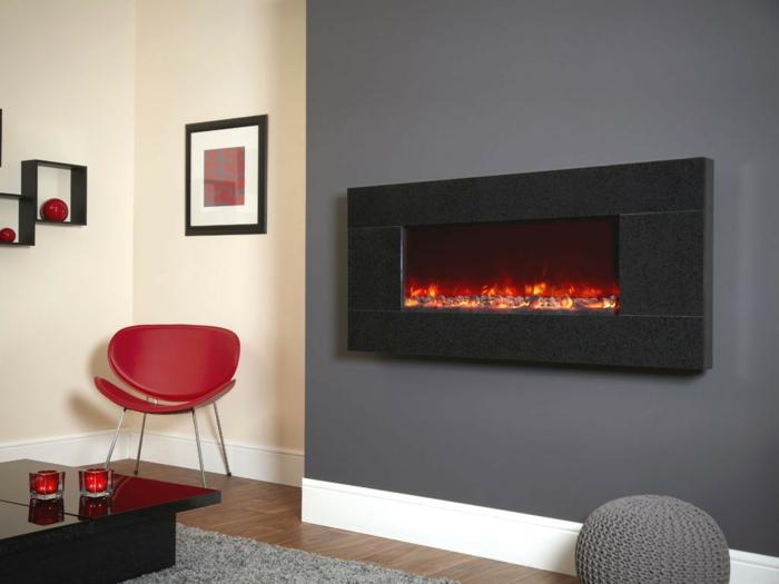 moderne kamine wandkamin elektrisch graue wand roter stuhl
