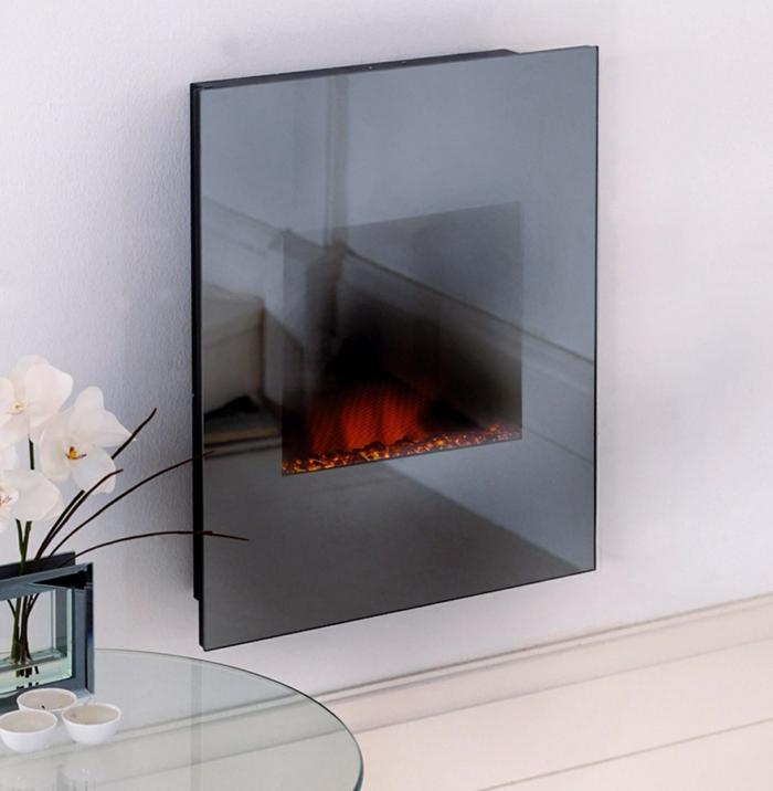 moderne kamine wand kamin elektrischer wandkamin gläserner tisch