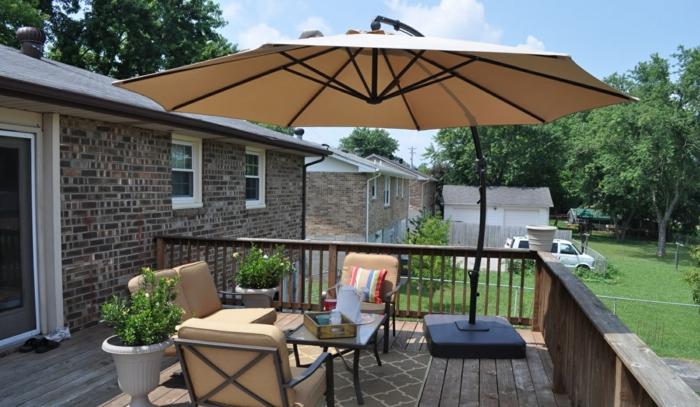 durch sonnenschirm balkon und garten vor der sonne schonen. Black Bedroom Furniture Sets. Home Design Ideas