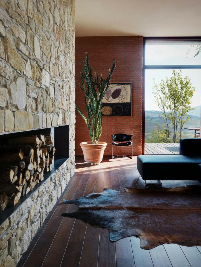 steinwand cooler fellteppich pflanzen schöne wohnideen