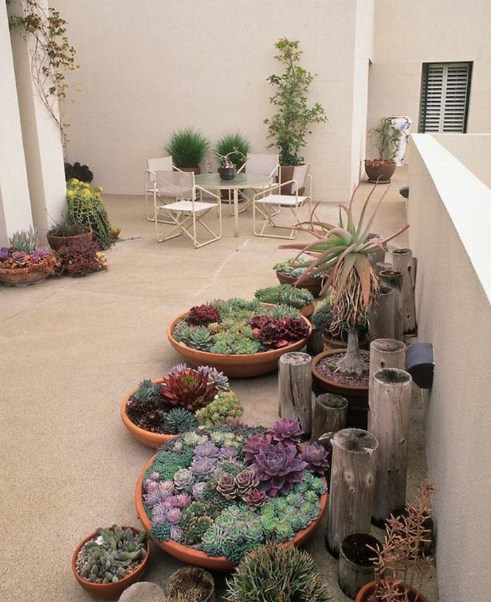 terrassenbepflanzung möbel und balkonpflanzen grüne terrassengestaltung ideen