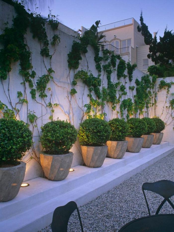 terrassengestaltung blumentöpfe außenbereich gestalten schöne leuchten
