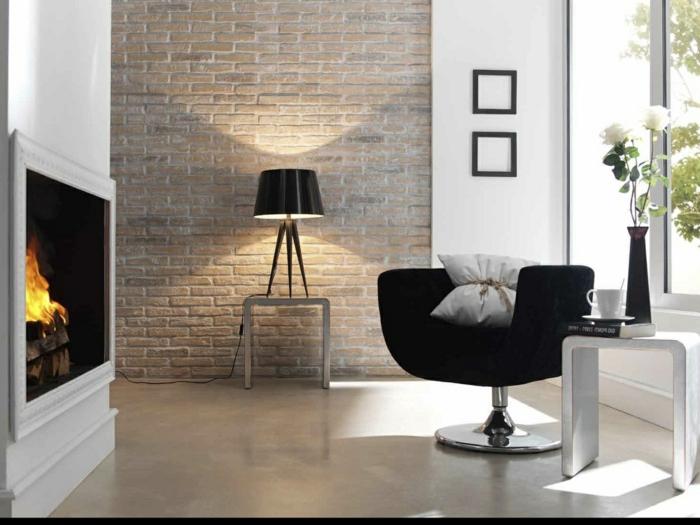 wohnzimmerbeleuchtung schwarzer sessel kamin originelle tischlampe