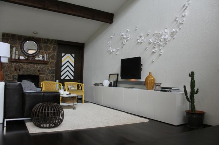 wohnzimmereinrichtung ideen weißer teppich schöne steinwand kaktus