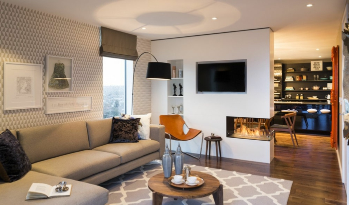 wohnzimmergestaltung runder couchtisch ecksofa sessel coole feuerstelle