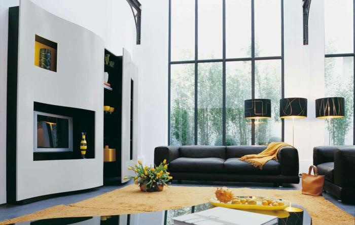 wohnzimmergestaltung kamin gelber teppich schwarze möbel gelbe ...