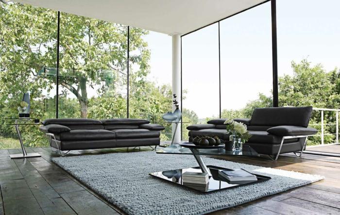 beistelltisch glas wohnzimmer ledersofa grauer teppich panoramafenster