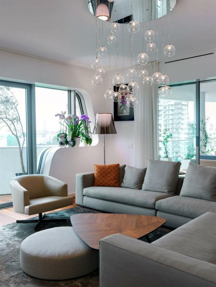 innendesign wohnzimmer graues sofa pendelleuchten cooler couchtisch