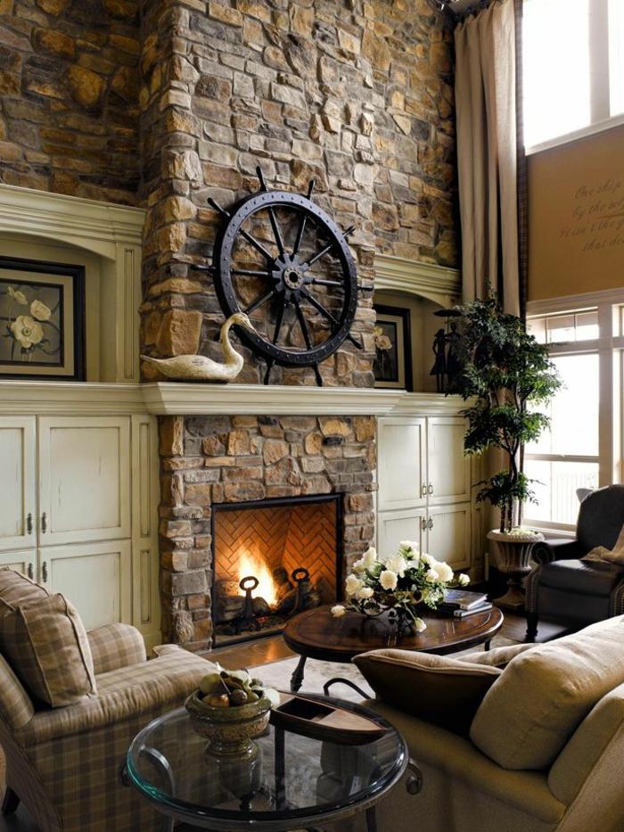kaminfeuer wohnzimmer steine wanndeko pflanzen