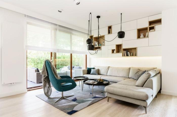 pendelleuchten wohnzimmer ecksofa teppich grüner sessel