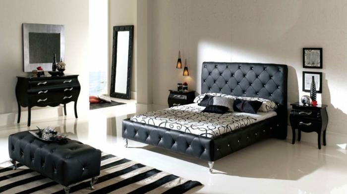 schlafzimmereinrichtung schwarze sitzbank leder streifenteppich