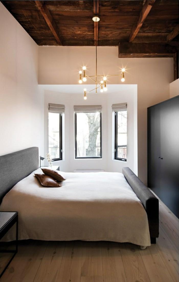 wohnideen schlafzimmer mit holz und schöner leuchter