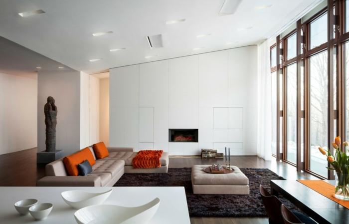 wohnzimmereinrichtung ideen kamin cooler couchtisch orange akzente