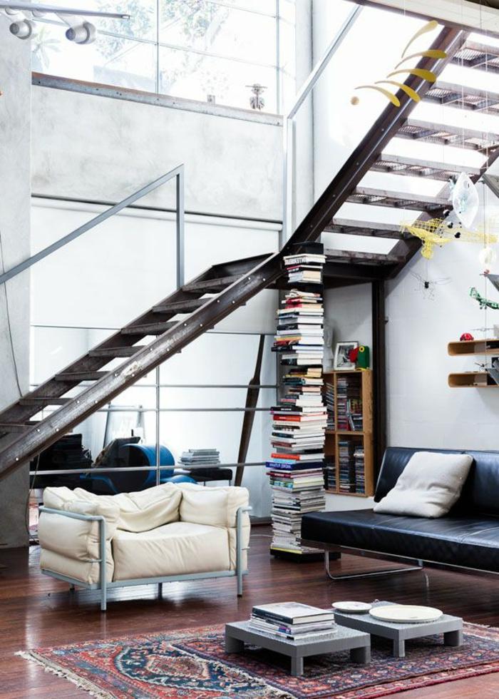 wohnzimmerideen industrieller stil teppich bücher