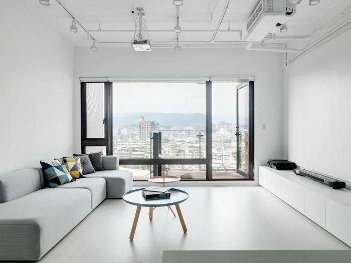 zimmergestaltung skandinavisches wohnzimmer weiße wandgestaltung runde tische