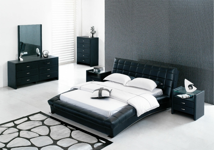 design betten schwarz leder komfort stil cooler teppich weiße wandfarbe schwarze kommode