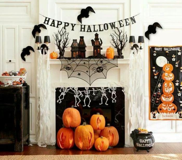 halloween ideen kamin dekorieren kürbisse fledermäuse
