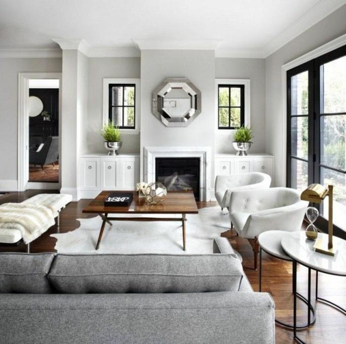 kamin design wohnzimmer einrichten weißer fellteppich graues sofa