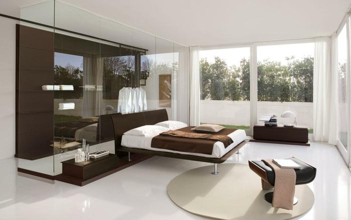 runder teppich elegante braune möbel panoramafenster