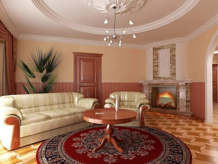 runder teppich wohnzimmer farbig wohnzimmermöbel pflanze kamin