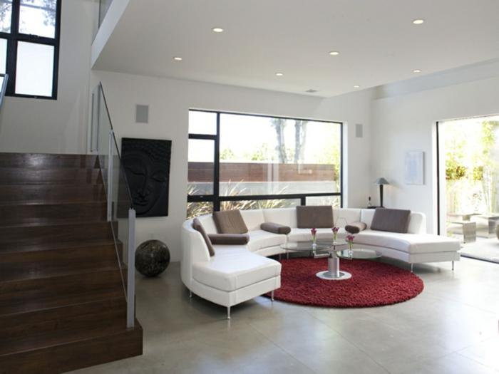 runder teppich wohnzimmer rot weißes sofa bodenfliesen
