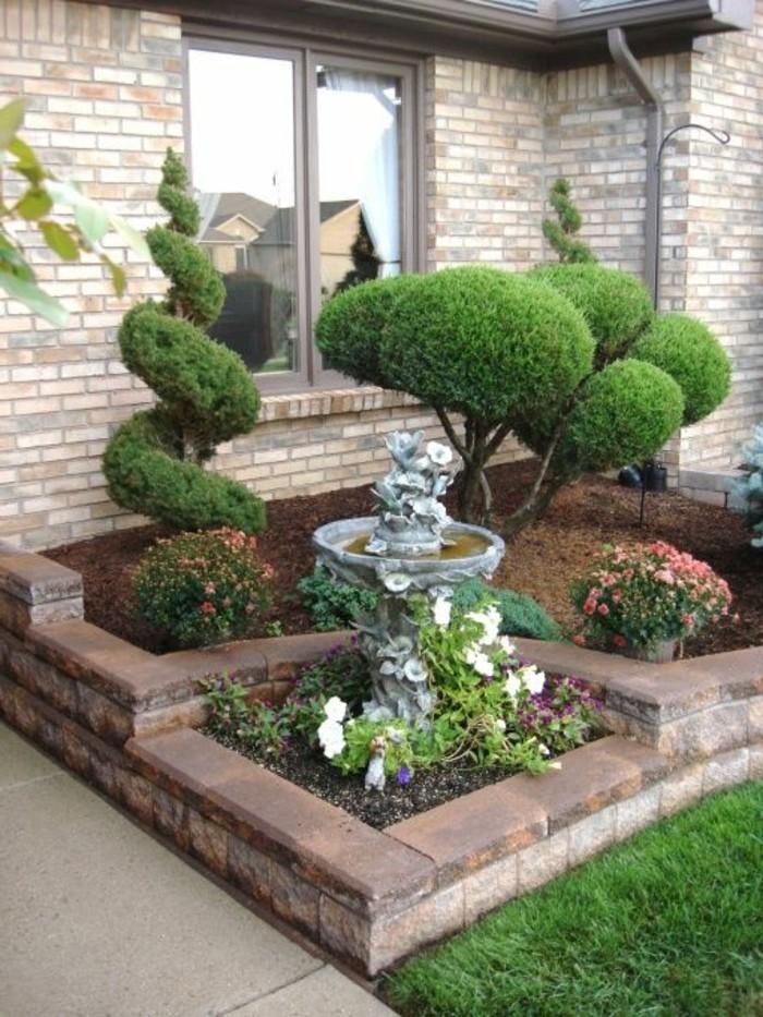 vorgartengestaltung ausgefallene dekoideen mit schönen pflanzen und gartenbrunnen