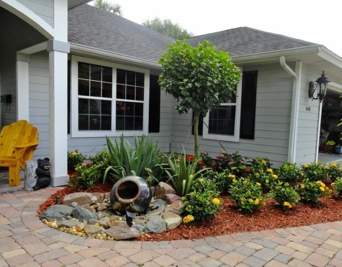 vorgartengestaltung geordneter vorgarten mit steinen