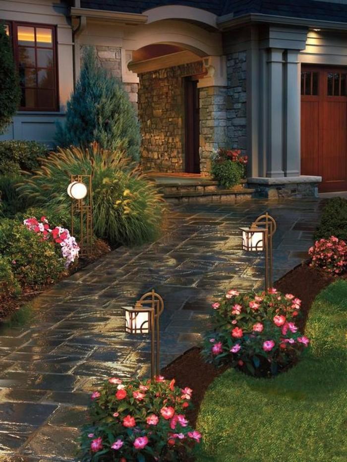 vorgartengestaltung mit romantischer beleuchtung und herrlichen blüten