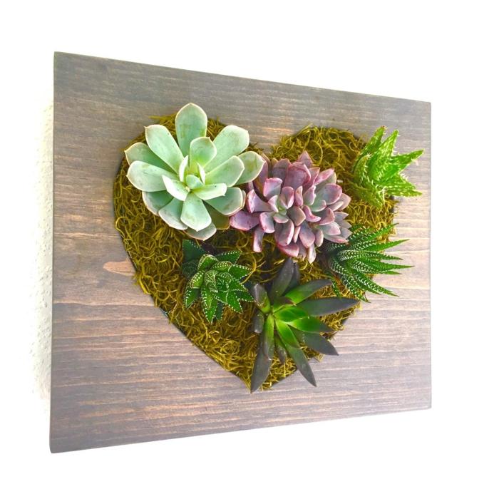 design de paredes em forma de coração vertical de jardim