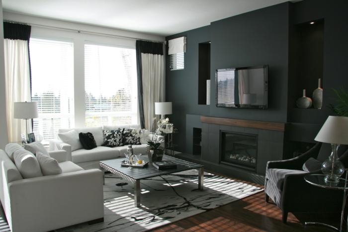 wände gestalten schwarze akzentwand schöner teppich weiße wohnzimmermöbel