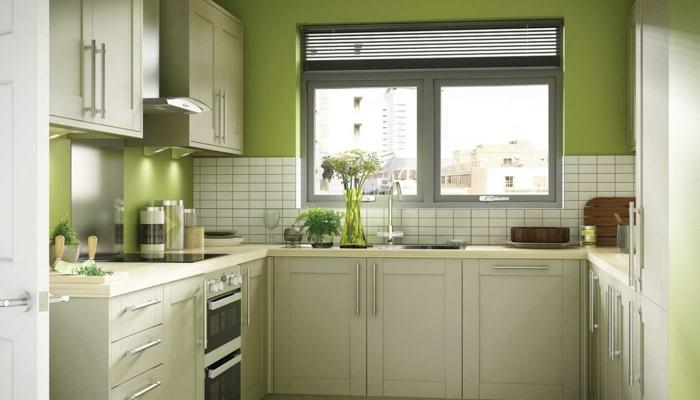 wandgestaltung küche grün weiße wandfliesen blumen fenster