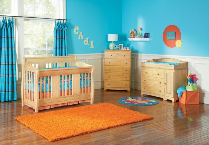 babybetten design babyzimmer oranger teppich blaue wandfarbe