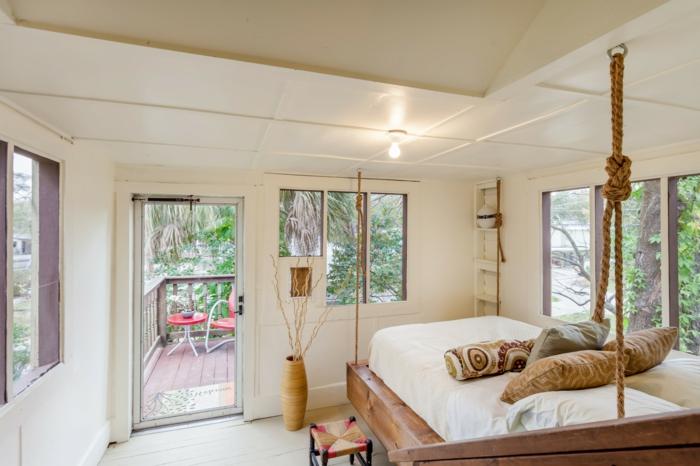 einrichtungsideen schlafzimmer hölzernes bett bodenvase kleines schlafzimmer
