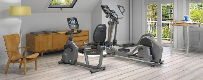 innendesign fitness geräte wohnzimmer kommode holzboden