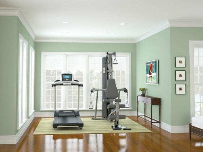 innendesign kleiner fitnesssraum teppich grüne wandfarbe sportbereich